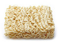 Raw chinese noodles on white background Royalty Free Stock Photos