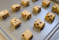 Raw cookie dough squares baking sheet Royalty Free Stock Image