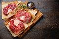 Raw cross cut veal shank for making osso buco fresh and seasonings on wooden cutting board Stock Photos