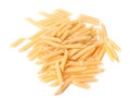 Raw and dry Penne noodles, isolated on a white background. Italian uncooked wheat pasta, close-up. Flour products.