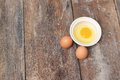 Raw egg in a bowl selective focus on wooden table Royalty Free Stock Photo