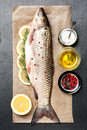 Raw fish carp with herbs and spices