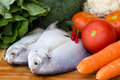 Raw fish with fresh vegetables Royalty Free Stock Photo