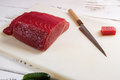 Raw fish meat and knife. Royalty Free Stock Photo