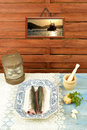 Raw fish ready to cook in the kitchen and decorated sailor Royalty Free Stock Photography