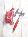 Raw fresh meat steak and ax selective focus Stock Photos