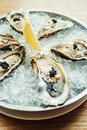 Raw and fresh Oyster with caviar on top and lemon
