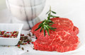 Raw fresh steaks from the marble beef, rosemary and spices Royalty Free Stock Photo