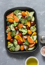 Raw fresh vegetables on a baking sheet. Sweet potato, zucchini, sweet pepper, cherry tomatoes, garlic, broccoli cabbage, olive oil Royalty Free Stock Photo
