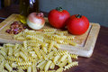 Raw fusilli with ingredients Stock Photography