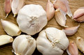 Raw garlic wooden plank Stock Photos