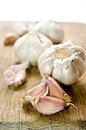 Raw garlic on a wooden plank Royalty Free Stock Photography