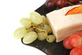 Raw grapes and cream cake on black Royalty Free Stock Photo