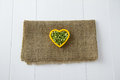 Raw green lentils nestled heart sitting burlap white wooden boards Royalty Free Stock Photo