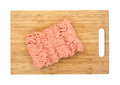 Raw ground chicken on wood cutting board Royalty Free Stock Photo