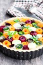 Raw  homemade  vegetarian pie with colored vegetables. Ready for Royalty Free Stock Photo