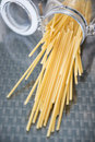 Raw italian spaghetti in jar Royalty Free Stock Photo