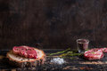 Raw juicy meat steak on dark wooden background ready to roasting Royalty Free Stock Photo