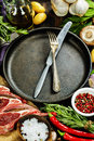 Raw lamb cutlets with vegetables herbs and spices Stock Photo