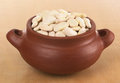 Raw lima beans butter in rustic bowl photographed on wood selective focus focus on the in the front of the bowl Stock Photography