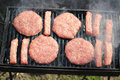 Raw Meat On A Barbecue Grill Stock Image