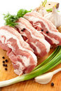 Raw meat with herbs and spices on the cutting boar Royalty Free Stock Images