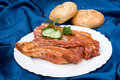 Raw meat with loafs of bread Stock Photography
