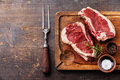 Raw meat Ribeye Steak, seasoning and meat fork Royalty Free Stock Photo