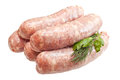 Raw meat sausages with greens isolated on white background Royalty Free Stock Images