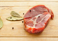 Raw meat with spices over wood background Royalty Free Stock Image