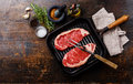 Raw meat Steak on frying pan and ingredients Royalty Free Stock Photo