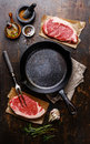 Raw meat Steak for two around iron frying pan Royalty Free Stock Photo