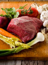 Raw meat with vegetables Stock Image