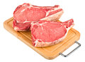 Raw meat on wood board Stock Image