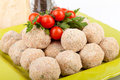 Raw meatballs plate with decorated with cherry tomatoes and parsley Royalty Free Stock Photos