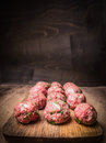 Raw minced meat balls with herbs and onions a vintage cutting board  close up Royalty Free Stock Photo