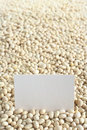Raw navy beans haricot boston pea yankee with a blank card selective focus focus on the card Stock Photos