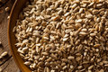 Raw organic hulled sunflower seeds in a bowl Stock Image