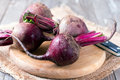 Raw organic red beets on wooden table Royalty Free Stock Photo