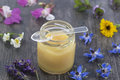 Raw organic royal jelly in a small bottle Royalty Free Stock Photo