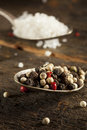 Raw organic sea salt and pepper against a background Stock Images