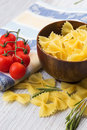 Raw pasta in bowl on white table selective focus Royalty Free Stock Photo