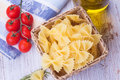Raw pasta in bucket on white table selective focus Royalty Free Stock Photography