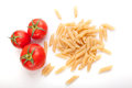 Raw pasta with cherry tomatoes top view Royalty Free Stock Images