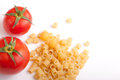 Raw pasta with cherry tomatoes with white space for your text here Royalty Free Stock Photos