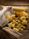 Raw pasta with ears and flour Stock Photos