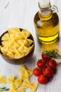 Raw pasta ferfalle in bowl on white table selective focus Stock Photo