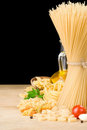 Raw pasta and food vegetable at black Stock Image