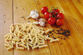 Raw Pasta Tomatoes Garlic Black Pepper Stock Images