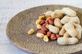Raw peanuts on a rustic plate Royalty Free Stock Photo